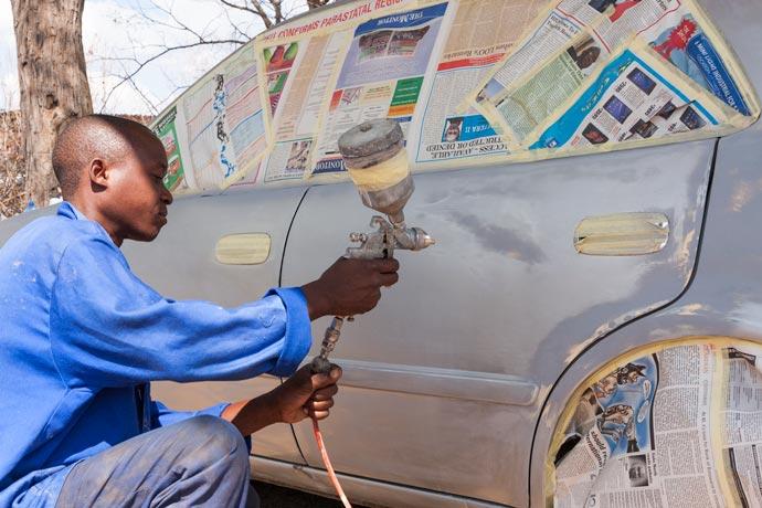 Spray Painting, Kasane, Botswana